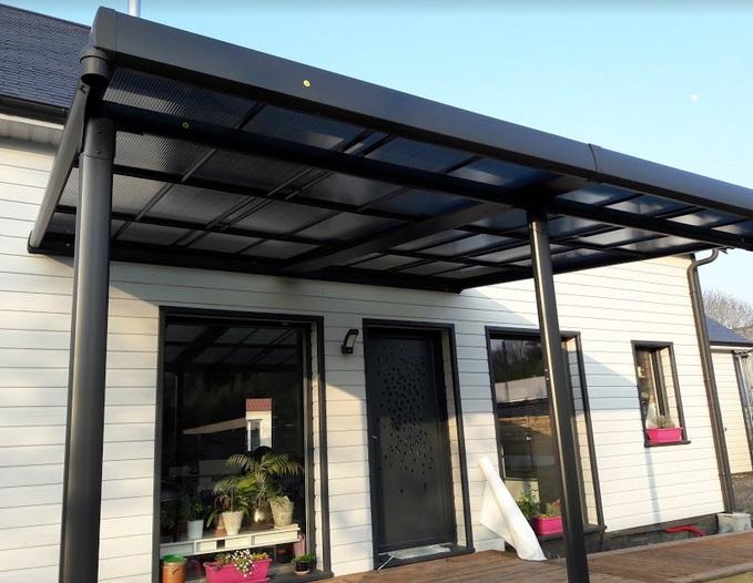 Ajout d'une terrasse avec toi en Zinc - Defi Énergies - Constructeur de maison en ossature bois